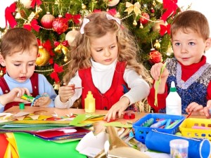 Kids making Christmas ornaments. via Shutterstock