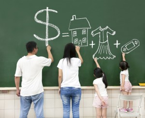 Teaching kids about money is easy if the whole family works together. Via Shutterstock.