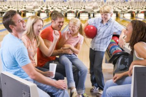 Score a FREE night of bowling for the whole family! Via Shutterstock.