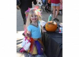 Tessa paints a pumpkin