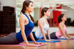 Socre a FREE week of yoga classes today. Via Shutterstock.