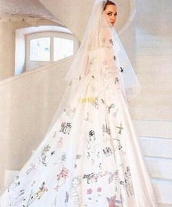 Angelina Jolie in a wedding dress decorated by her children.