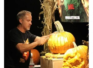 Jon Neill carves a pumpkin