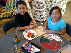 Justin and Cayden get ready to make puzzle piece ornaments
