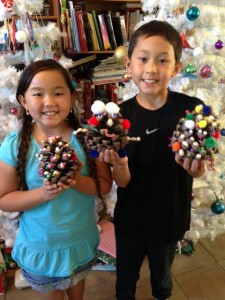Cayden and Justin and their finished pinecone trees