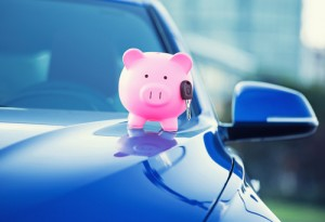 Make sure your car insurance doesn't drain your piggy bank with these money saving tips. Via Shutterstock.