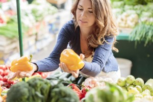 Picking out organic vegetables via shutterstock